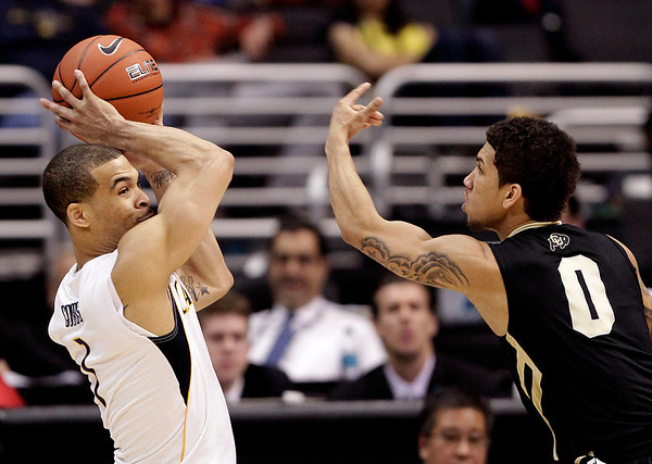 P12 Colorado California(2).JPG California's Justin Cobbs, left, looks to pass as he is defended by Colorado's Askia Booker during the second half of an NCAA college basketball game in the semifinals of the Pac-12 conference championship in Los Angeles, Friday, March 9, 2012. Colorado won 70-59. (AP Photo/Jae C. Hong)