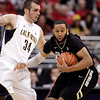 P12 Colorado California(11).JPG Colorado's Carlon Brown, right, is defended by California's Robert Thurman during the first half of an NCAA college basketball game in the semifinals of the Pac-12 conference championship in Los Angeles, Friday, March 9, 2012. (AP Photo/Jae C. Hong)