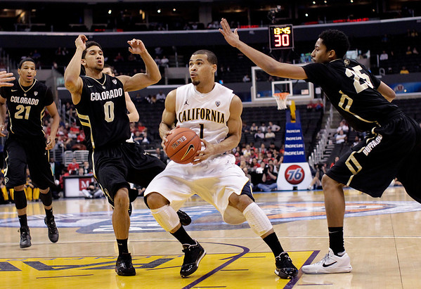 Colorado California Basketb.JPG California's Justin Cobbs, center, is defended by Colorado's Askia Booker, left, and Spencer Dinwiddie during the first half of an NCAA college basketball game in the semifinals of the Pac-12 conference championship in Los Angeles, Friday, March 9, 2012. (AP Photo/Jae C. Hong)