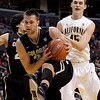 P12 Colorado California(12).JPG Colorado's Austin Dufault, center, gets a rebound against California's David Kravish during the first half of an NCAA college basketball game in the semifinals of the Pac-12 conference championship in Los Angeles, Friday, March 9, 2012. (AP Photo/Jae C. Hong)