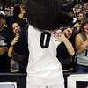Jariya Phanpaktra, left, and Kristen Conrad, have hugs for Chip at the game on Sunday.<br /> University of Colorado basketball fans raise the roof at the CU Air Force on November 25th, 2012.<br /> Cliff Grassmick / November 25, 2012