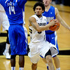 Askia Booker of CU drives past Michael Lyons of Air Force on Sunday.<br /> Cliff Grassmick / November 25, 2012