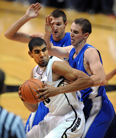 Josh Scott of CU goes to the basket against Air Force.<br /> Cliff Grassmick / November 25, 2012