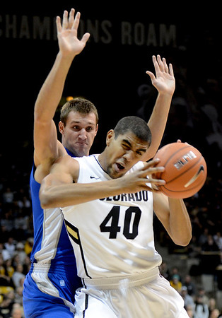 "Josh Scott of Colorado tries to muscle Taylor Broekhuis of Air Force during the first half of the game in Boulder, Colorado, on November 25, 2012.<br /> For more photos of the game, go to  <a href=""http://www.dailycamera.com"">http://www.dailycamera.com</a>.<br /> Cliff Grassmick / November 25, 2012"