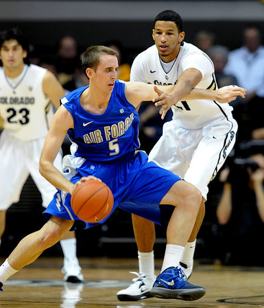 """Mike Fitzgerald of Air Force tries to drive around Andre Roberson of Colorado during the first half of the game in Boulder, Colorado, on November 25, 2012.<br /> For more photos of the game, go to  <a href=""""http://www.dailycamera.com"""">http://www.dailycamera.com</a>.<br /> Cliff Grassmick / November 25, 2012"""