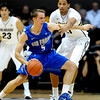 "Mike Fitzgerald of Air Force tries to drive around Andre Roberson of Colorado during the first half of the game in Boulder, Colorado, on November 25, 2012.<br /> For more photos of the game, go to  <a href=""http://www.dailycamera.com"">http://www.dailycamera.com</a>.<br /> Cliff Grassmick / November 25, 2012"