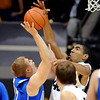 "Josh Scott, right, of Colorado, blocks the shot of Chase Kammerer of Air Force during the first half of the game in Boulder, Colorado, on November 25, 2012.<br /> For more photos of the game, go to  <a href=""http://www.dailycamera.com"">http://www.dailycamera.com</a>.<br /> Cliff Grassmick / November 25, 2012"