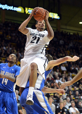 """Andre Roberson of Colorado comes down on Taylor Broekhuis of Air Force after a rebound during the first half of the game in Boulder, Colorado, on November 25, 2012.<br /> For more photos of the game, go to  <a href=""""http://www.dailycamera.com"""">http://www.dailycamera.com</a>.<br /> Cliff Grassmick / November 25, 2012"""