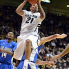 "Andre Roberson of Colorado comes down on Taylor Broekhuis of Air Force after a rebound during the first half of the game in Boulder, Colorado, on November 25, 2012.<br /> For more photos of the game, go to  <a href=""http://www.dailycamera.com"">http://www.dailycamera.com</a>.<br /> Cliff Grassmick / November 25, 2012"