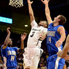 "Xavier Talton of Colorado drives past Taylor Broekhuis of Air Force during the first half of the game in Boulder, Colorado, on November 25, 2012.<br /> For more photos of the game, go to  <a href=""http://www.dailycamera.com"">http://www.dailycamera.com</a>.<br /> Cliff Grassmick / November 25, 2012"