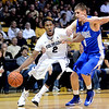 "Xavier Johnson of Colorado drives on Marek Olesinski of Air Force during the first half of the game in Boulder, Colorado, on November 25, 2012.<br /> For more photos of the game, go to  <a href=""http://www.dailycamera.com"">http://www.dailycamera.com</a>.<br /> Cliff Grassmick / November 25, 2012"
