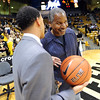 Rodney Billups, left, says hello to former CU basketball player, Jay Humphries at the Air Force game.<br /> University of Colorado basketball fans raise the roof at the CU Air Force on November 25th, 2012.<br /> Cliff Grassmick / November 25, 2012