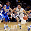 """Askia Booker of Colorado drives on Kyle Green of Air Force during the first half of the game in Boulder, Colorado, on November 25, 2012.<br /> For more photos of the game, go to  <a href=""""http://www.dailycamera.com"""">http://www.dailycamera.com</a>.<br /> Cliff Grassmick / November 25, 2012"""