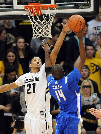 Andre Roberson of CU goes up to block the shot of Michael Lyons of Air Force.<br /> Cliff Grassmick / November 25, 2012