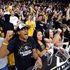 Shreyash Pradhan, left, Jariya Phanpaktra, and Kristen Conrad, are among CU students cheering on the Buffs basketball team.<br /> University of Colorado basketball fans raise the roof at the CU Air Force on November 25th, 2012.<br /> Cliff Grassmick / November 25, 2012