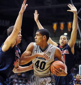 Josh Scott of CU works against Kaleb Tarczewski of Arizona. For more photos of the game, go to www.dailycamera.com. Cliff Grassmick / February 14, 2013