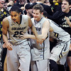 "Spencer Dinwiddie, left, and Beau Gamble celebrate the win over Arizona with the fans.<br /> For more photos of the game, go to  <a href=""http://www.dailycamera.com"">http://www.dailycamera.com</a>.<br /> Cliff Grassmick / February 14, 2013"