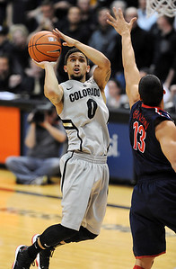 Askia Booker of CU  puts up a shot on Nick Johnson of Arizona. For more photos of the game, go to www.dailycamera.com. Cliff Grassmick / February 14, 2013