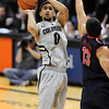 "Askia Booker of CU  puts up a shot on Nick Johnson of Arizona.<br /> For more photos of the game, go to  <a href=""http://www.dailycamera.com"">http://www.dailycamera.com</a>.<br /> Cliff Grassmick / February 14, 2013"