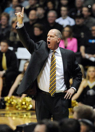 "CU head coach Tad Boyle calls out a play against Arizona.<br /> For more photos of the game, go to  <a href=""http://www.dailycamera.com"">http://www.dailycamera.com</a>.<br /> Cliff Grassmick / February 14, 2013"