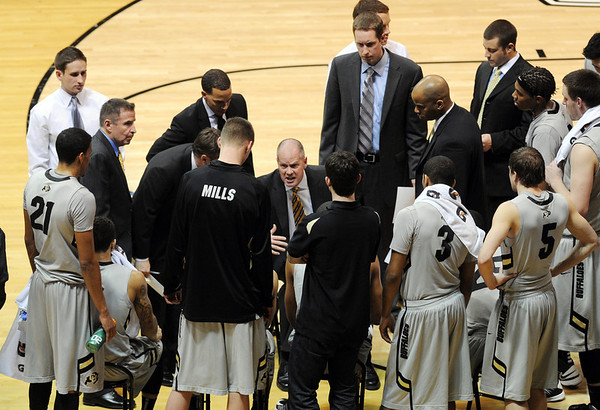 "Tad Boyle with the CU team during a time out against Arizona.<br /> For more photos of the game, go to  <a href=""http://www.dailycamera.com"">http://www.dailycamera.com</a>.<br /> Cliff Grassmick / February 14, 2013"