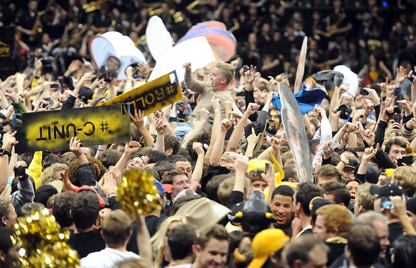 "Hundreds of CU basketball fans rush the court after the upset win over Arizona.<br /> For more photos of the game, go to  <a href=""http://www.dailycamera.com"">http://www.dailycamera.com</a>.<br /> Cliff Grassmick / February 14, 2013"