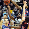"Jeremy Adams of CU gets his shot blocked by  Kevin Parrom of Arizona.<br /> For more photos of the game, go to  <a href=""http://www.dailycamera.com"">http://www.dailycamera.com</a>.<br /> Cliff Grassmick / February 14, 2013"