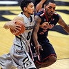"Askia Booker of CU drives on Mark Lyons of Arizona.<br /> For more photos of the game, go to  <a href=""http://www.dailycamera.com"">http://www.dailycamera.com</a>.<br /> Cliff Grassmick / February 14, 2013"