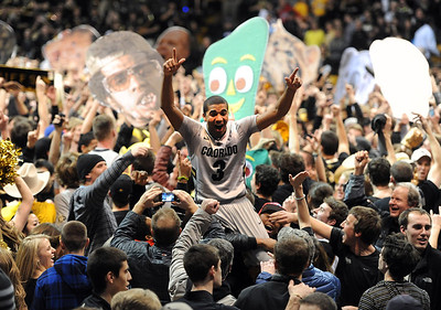 Xavier Talton gets carried away with the CU basketball fans after the Buffs upset Arizona. For more photos of the game, go to www.dailycamera.com. Cliff Grassmick / February 14, 2013