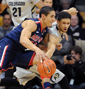 Askia Booker of CU tries to get the steal against Nick Johnson of Arizona. For more photos of the game, go to www.dailycamera.com. Cliff Grassmick / February 14, 2013