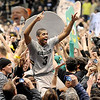 "Xavier Talton is carried off the court by CU fans that rushed the court after CU beat Arizona 71-58.<br /> For more photos of the game, go to  <a href=""http://www.dailycamera.com"">http://www.dailycamera.com</a>.<br /> Cliff Grassmick / February 14, 2013"