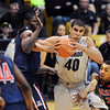 "Josh Scott (40) of CU works against Angelo Chol, left, and Mark Lyons, of Arizona.<br /> For more photos of the game, go to  <a href=""http://www.dailycamera.com"">http://www.dailycamera.com</a>.<br /> Cliff Grassmick / February 14, 2013"