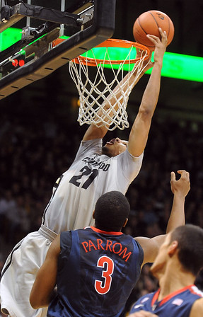 "Andre Roberson of CU puts back an offensive rebound over Kevin Parrom of Arizona.<br /> For more photos of the game, go to  <a href=""http://www.dailycamera.com"">http://www.dailycamera.com</a>.<br /> Cliff Grassmick / February 14, 2013"