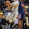 "Andre Roberson of CU drives past Solomon Hill of Arizona.<br /> For more photos of the game, go to  <a href=""http://www.dailycamera.com"">http://www.dailycamera.com</a>.<br /> Cliff Grassmick / February 14, 2013"
