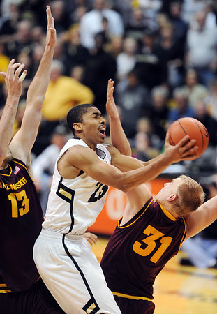 "Spencer Dinwiddie of CU drives into Jonathan Gilling of ASU during the second half of the February 16th, 2013 game in Boulder.<br /> For more photos of the game, go to  <a href=""http://www.dailycamera.com"">http://www.dailycamera.com</a>.<br /> Cliff Grassmick / February 16, 2013"