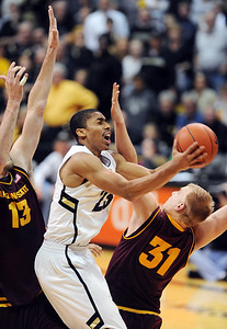 Spencer Dinwiddie of CU drives into Jonathan Gilling of ASU during the second half of the February 16th, 2013 game in Boulder. For more photos of the game, go to www.dailycamera.com. Cliff Grassmick / February 16, 2013