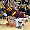"Evan Gordan (10) of Arizona State falls on Jeremy Adams of Colorado going for a loose ball during the first half of the February 16th, 2013 game in Boulder.<br /> For more photos of the game, go to  <a href=""http://www.dailycamera.com"">http://www.dailycamera.com</a>.<br /> Cliff Grassmick / February 16, 2013"