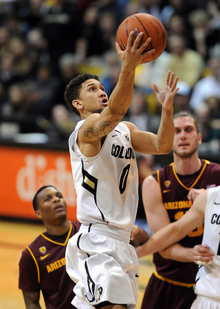 """Askia Booker of CU drives to the basket during the second half of the   February 16th, 2013  ASU game in Boulder.<br /> For more photos of the game, go to  <a href=""""http://www.dailycamera.com"""">http://www.dailycamera.com</a>.<br /> Cliff Grassmick / February 16, 2013"""