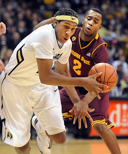 Xavier Johnson of CU drives past Chris Colvin of ASU during the first half of the February 16th, 2013 game in Boulder. For more photos of the game, go to www.dailycamera.com. Cliff Grassmick / February 16, 2013