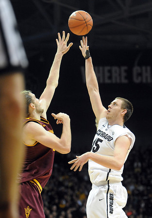 "Shane Harris-Tunks shoots a sky hook on Jordan Bachynski of ASU during the first half of the February 16th, 2013 game in Boulder.<br /> For more photos of the game, go to  <a href=""http://www.dailycamera.com"">http://www.dailycamera.com</a>.<br /> Cliff Grassmick / February 16, 2013"