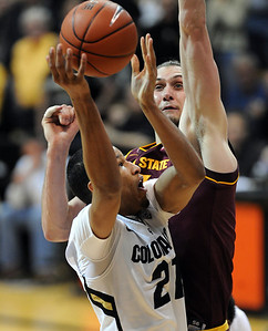 Andre Roberson tries to score on Jordan Bachynski of ASU during the second half of the February 16th, 2013 game in Boulder. For more photos of the game, go to www.dailycamera.com. Cliff Grassmick / February 16, 2013