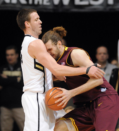 "Jordan Bachynski of Arizona State runs into Shane Harris-Tunks of Colorado during the first half of the February 16th, 2013 game in Boulder.<br /> For more photos of the game, go to  <a href=""http://www.dailycamera.com"">http://www.dailycamera.com</a>.<br /> Cliff Grassmick / February 16, 2013"