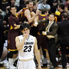 "A disappointed Sabatino Chen of Colorado walks off  the court after the overtime loss, while Arizona State players celebrate in the background during the  February 16th, 2013 game in Boulder.<br /> For more photos of the game, go to  <a href=""http://www.dailycamera.com"">http://www.dailycamera.com</a>.<br /> Cliff Grassmick / February 16, 2013"