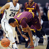 "Jahii Carson of Arizona State looses control of the ball in front of Spencer Dinwiddie of Colorado during the first half of the February 16th, 2013 game in Boulder.<br /> For more photos of the game, go to  <a href=""http://www.dailycamera.com"">http://www.dailycamera.com</a>.<br /> Cliff Grassmick / February 16, 2013"
