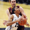 "Spencer Dinwiddie of CU tries to score on Jordan Bachynski of ASU during the second half of the February 16th, 2013 game in Boulder.<br /> For more photos of the game, go to  <a href=""http://www.dailycamera.com"">http://www.dailycamera.com</a>.<br /> Cliff Grassmick / February 16, 2013"