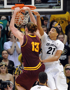 Jordan Bachynski of Arizona State dunks past Andre Roberson of Colorado during the second half of the February 16th, 2013 game in Boulder. For more photos of the game, go to www.dailycamera.com. Cliff Grassmick / February 16, 2013