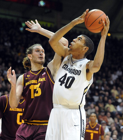 "Josh Scott of Colorado looks to shoot over Jordan Bachynski of Arizona State during the first half of the February 16th, 2013 game in Boulder.<br /> For more photos of the game, go to  <a href=""http://www.dailycamera.com"">http://www.dailycamera.com</a>.<br /> Cliff Grassmick / February 16, 2013"