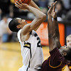 "Spencer Dinwiddie puts up a late shot over Jarett Upchurch of Arizona State during the overtime period of the February 16th, 2013 game in Boulder.<br /> For more photos of the game, go to  <a href=""http://www.dailycamera.com"">http://www.dailycamera.com</a>.<br /> Cliff Grassmick / February 16, 2013"