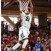 Colorado's Andre Roberson, left, dunks the ball as Dayton's Devin Oliver looks on during the first half of an NCAA college basketball game at the Charleston Classic at TD Arena, Thursday Nov. 15, 2012, in Charleston, S.C.   (AP Photo/Mic Smith)