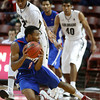 Dayton's Vee Sanford, bottom, falls to the court as Colorado's Xavier Johnson, left, defends during the second half of an NCAA college basketball game at the Charleston Classic at TD Arena, Thursday Nov. 15, 2012, in Charleston, S.C. (AP Photo/Mic Smith)